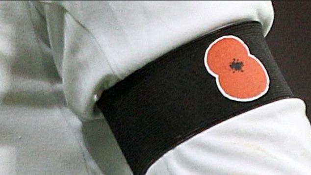 remembrance-poppy-on-black-arm-band